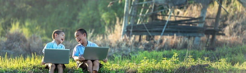 children talking with their laptops