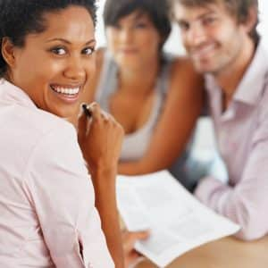 smiling advisor with happy couple