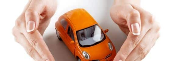 car insurance hands around car